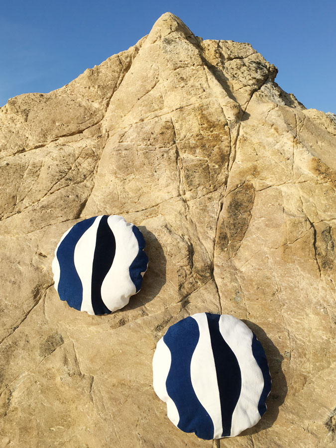 White and blue circular design cushions by Sonia Laudet